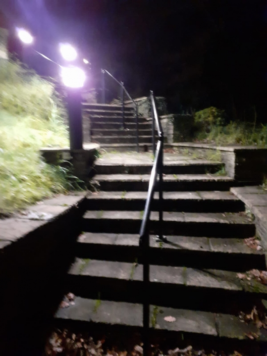 Steps down to the Church as lit at night